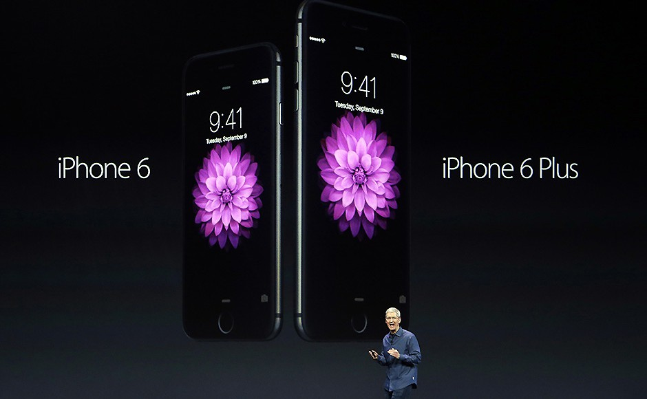 Apple CEO Tim Cook introduces the new iPhone 6 and iPhone 6 Plus on Tuesday, Sept. 9, 2014, in Cupertino, Calif. Pic: AP