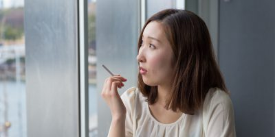 asian woman with cigarette